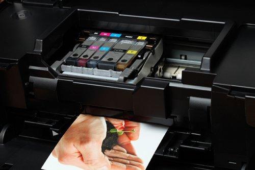 Наш принтер снова печатает, после того как его заправили